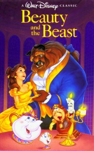 Belle voiced by Paige O'Hara in her iconic gold ballgown on the VHS cover.