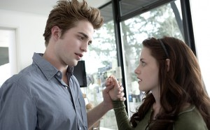 Kristen Stewart and Robert Pattinson as Bella Swan and Edward Cullen