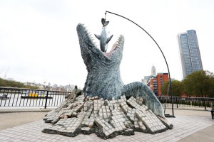 The Mosasaurus is now at London's South Bank emerging from the River Thames.