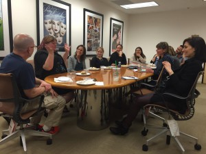 Author Cassandra Clare talks with production team