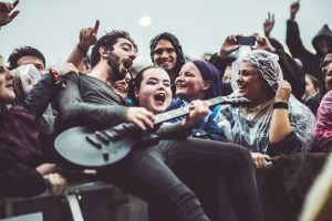 As the crowd are swallowed by the mud, Jack is swallowed by the crowd. Image via Ross Silcocks.