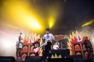 Neck Deep seek to combat the rain with their own burning solution. Image via Ben Gibson